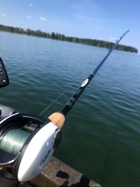 Cabelas baitcaster on sunny day, kayak fishing