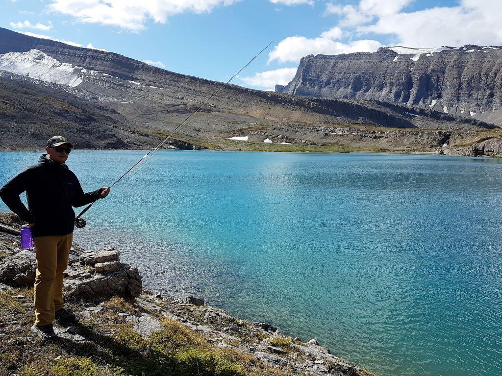 Fly fishing alpine lake