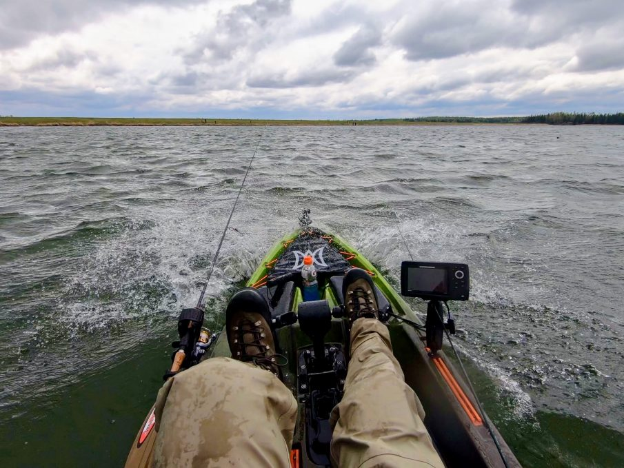 Waves over kayak bow
