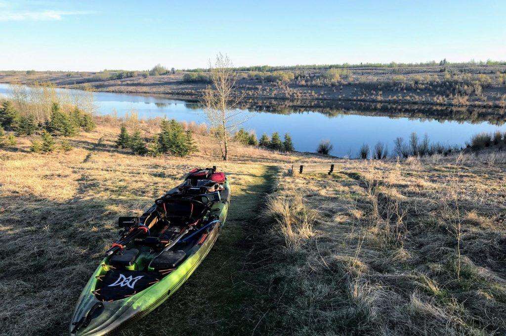 Kayak on hill overlooking lake