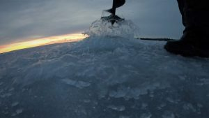 Ice auger cutting