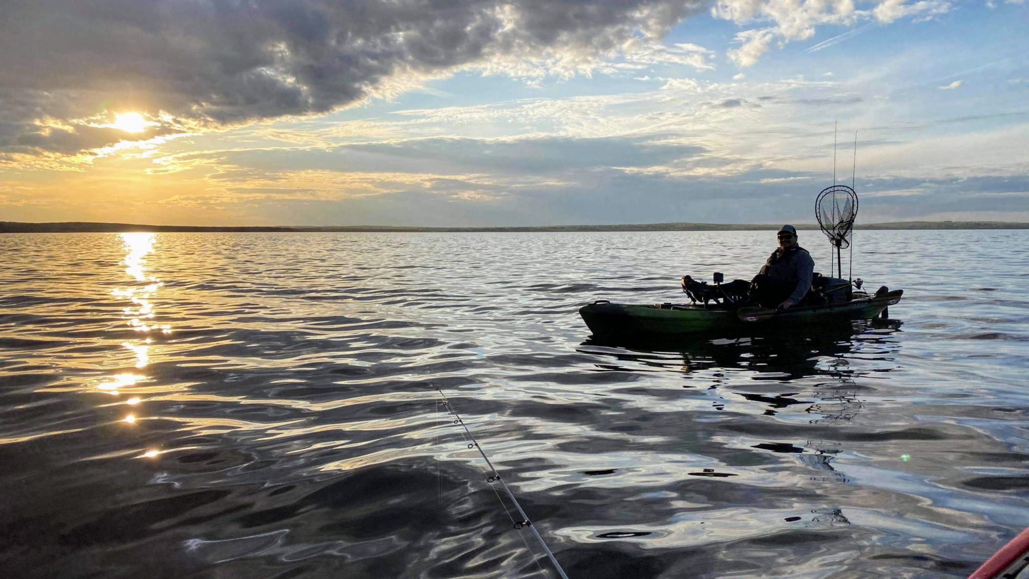 kayak fishing sunset